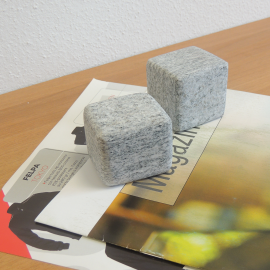 Polished gray gneiss paper blocks